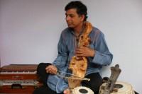 man playing Nepali sarangi