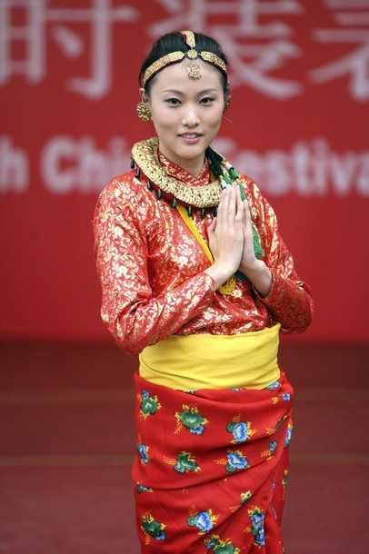 A Chinese Model Wears A Traditional Nepali Costume During