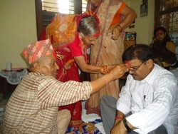 Receiving Tika from the elders.